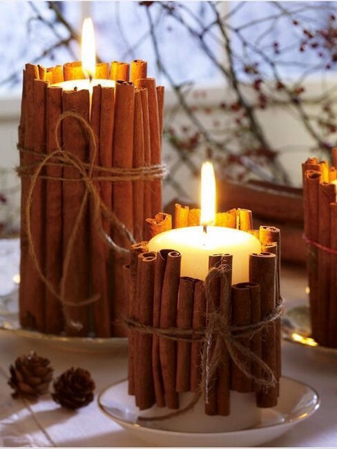 Decorate a pillar candle with cinnamon sticks to dress up a plain candle as well as infuse the warm smell of cinnamon throughout your house. The heat works to spread the cinnamon. Tie with string.