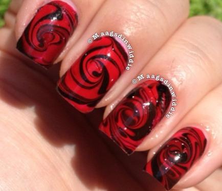 Дизайн ногтей черный с красными розами
