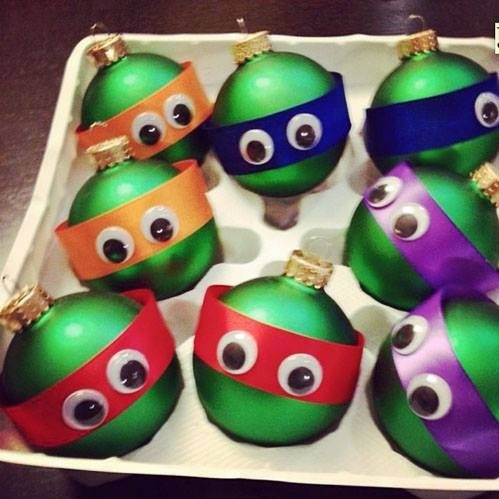 Teenage mutant ninja turtle ornaments are easy to make with some green ornament balls, ribbon and google eyes!