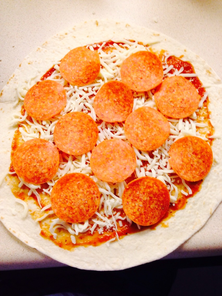 Top ur tortilla like u would a pizza leaving a little space around the edge