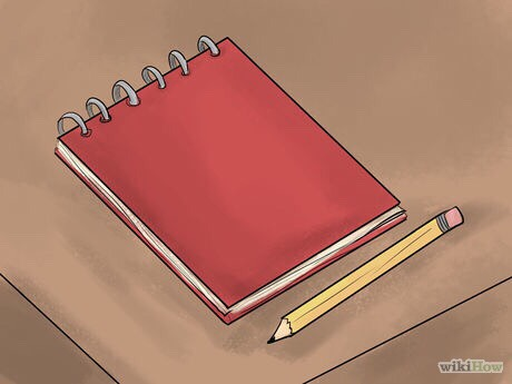 2. Put a pad and pen or pencil within easy reach of your bed. It's best if it just has plain paper with no designs or other distractions. Use this pad only for recording your dreams.