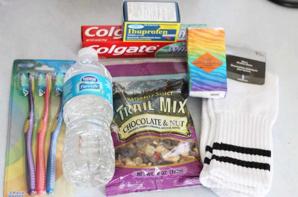 Here is a good idea for what to include: 1) a toothbrush 2) a bottle of water  3) trail mix, or some kind of snack 4) toothpaste  5) ibuprofen, or tylenol  6) a travel size pack of tissues 7) and a pair of socks!