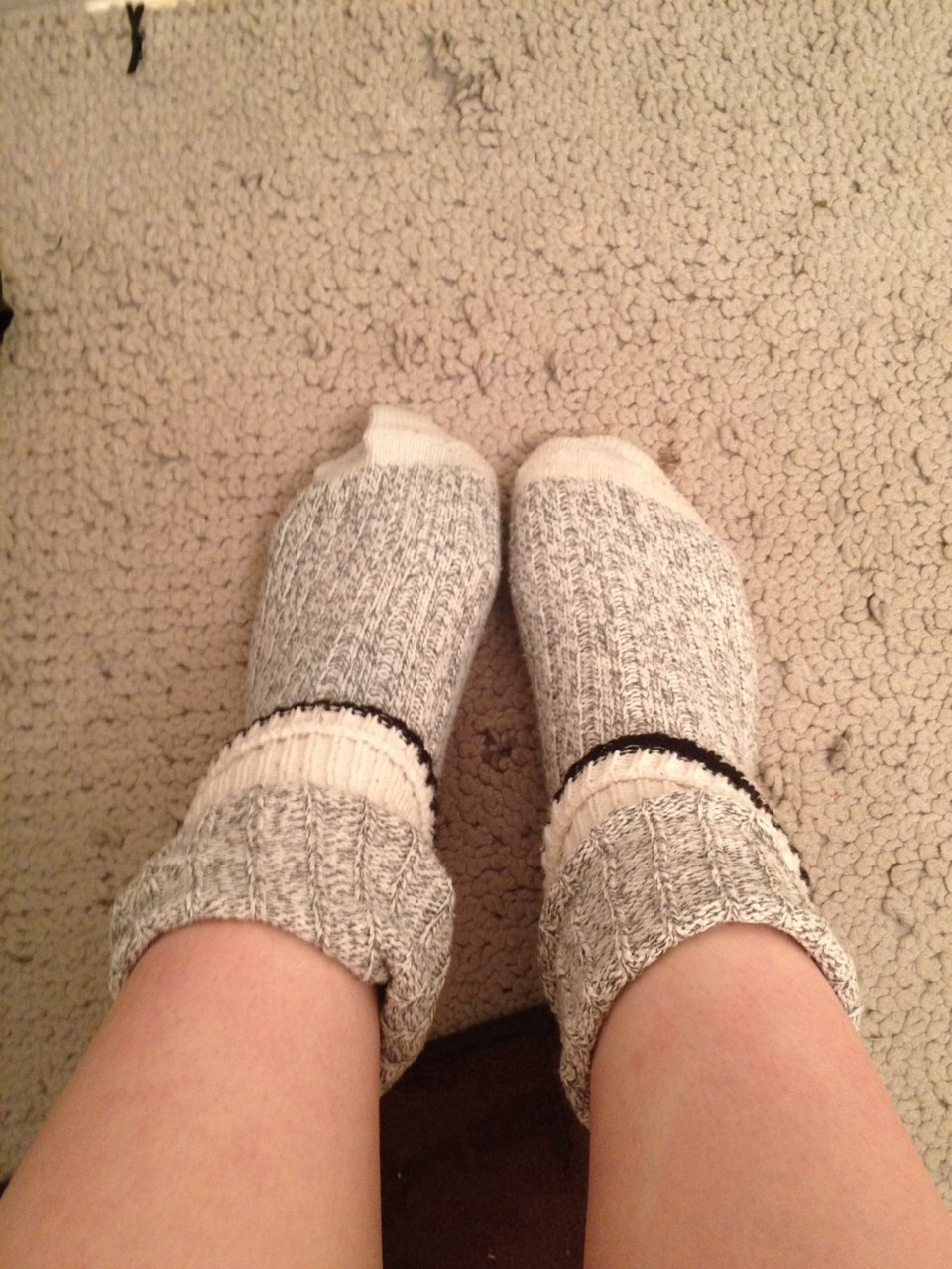 Put on some wool socks over top and go to bed. They should be dry by morning making you feel a little less sick.