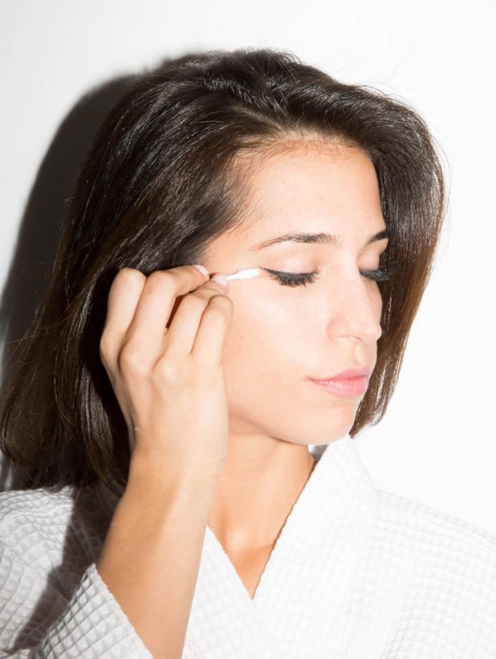 6. If you love winged liner but don't have the hand-eye coordination to do it perfectly, no big deal: You can clean messy edges with a cotton swab coated with petroleum jelly. Making the perfect freehanded flick on the first try is hard. Erasing your mistakes is easy.