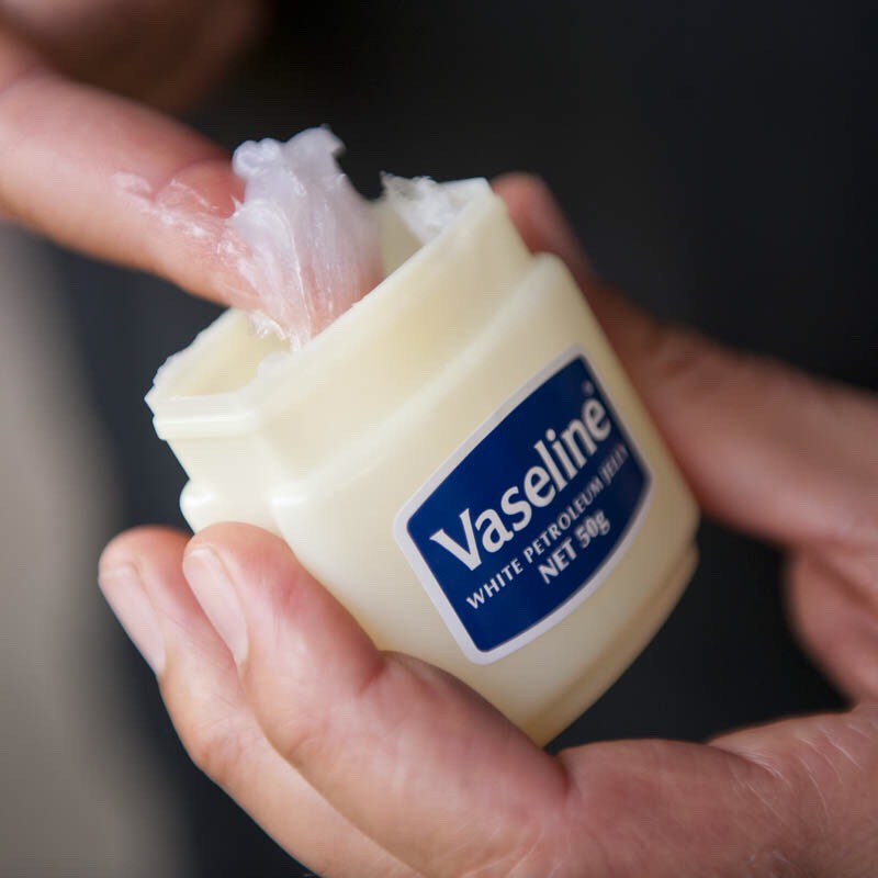 While you're waiting put the Vaseline on The parts of your skin that you do not want to dye. And put on a old T-shirt that you don't mind staining.