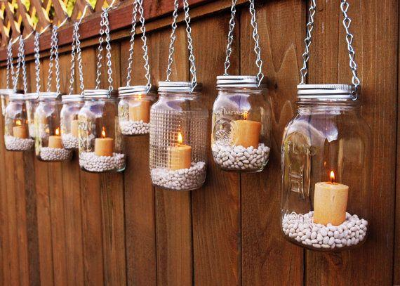 use mason jars and white pebbles! so adorable and cute.
