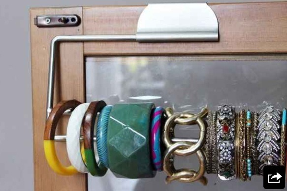Use paper towel rods to organize bracelets.