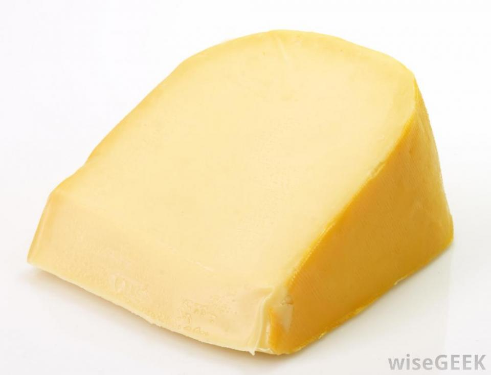 I prefer smoked gouda cheese but you can use swiss.  Lay 2-3 slices on each piece of chicken.