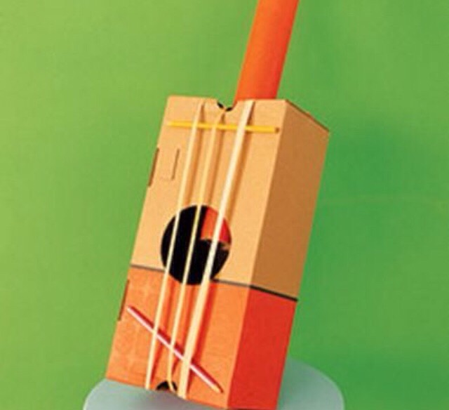 Use a tissue box and rubber bands to create a guitar!