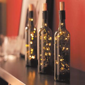 : Decorate the bottles with a ribbon, some wrapping ties or a Christmas decoration. This would make a great present with some nice shot glasses.