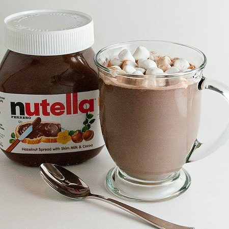Want this well good🙊 1.scoop 1tablespoon if Nutella into a mug and fill the rest with milk 2. Put it in the microwave for 2 minutes and stir 3. Put it in for another 1 minute  4.keep stirring when you drink it as the Nutella likes to rise at the top.  5. Top with cream and marshmallows
