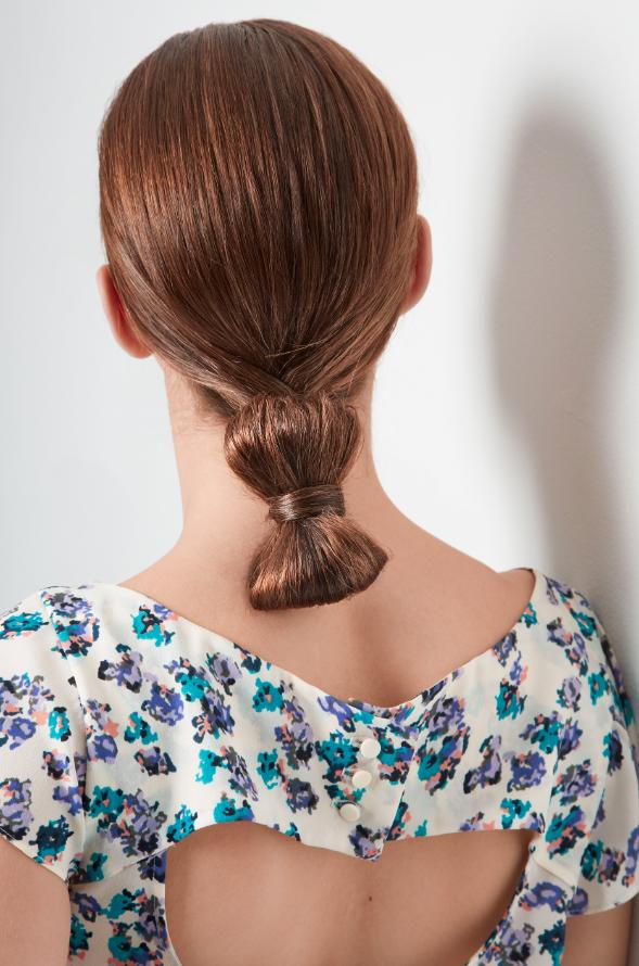 6. Create a sideways bow by making a loop with your tail and wrapping a piece of hair around the middle of it.