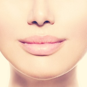 You need to start by exfoliating your lips, to do this you just rub some sugar and honey onto your lips, the sugar exfoliates, the honey replenishes lost moisture.