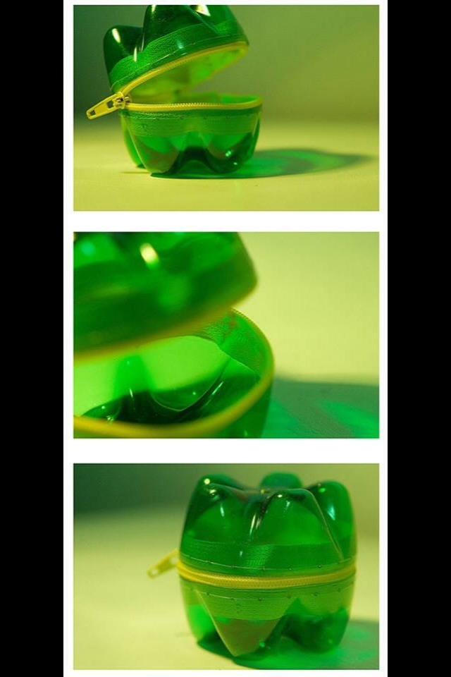 Cut the bottoms off of a soda bottle then glue on zipper. EASY! CHEAP!