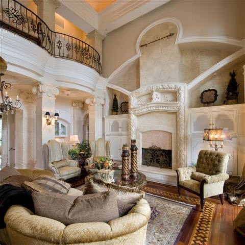 Love the fireplace and the vintage chairs are A number 1