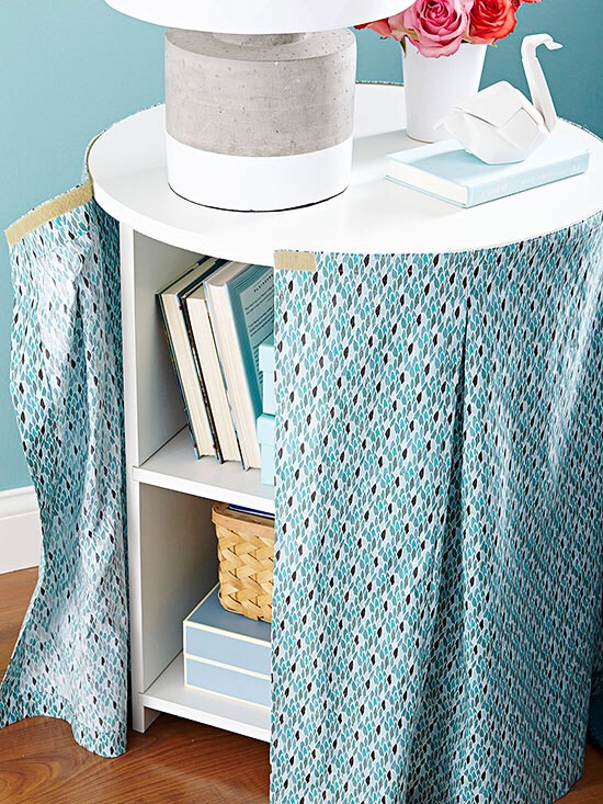 Hide Your Storage Not all items to be stored need be in view. Furniture tricks -- here, a table skirt with a pretty pattern -- help to hide shelves, baskets, and the like for a clean look that still boosts storage.