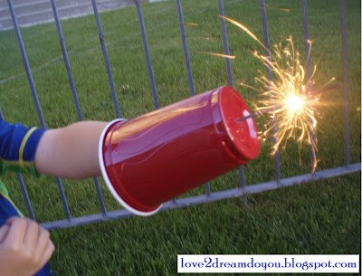 Sparkler Shield.  Use a plastic cup as a sparkler shield to keep those little hands from the hot sticks!