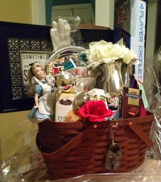 "Alice in Wonderland gift basket (Doll, Book, Tea bags/leaves, Tea Pot, Tea cup, scones, chocolates, ""Drink Me"" bottle, red roses, playing cards etc.)"