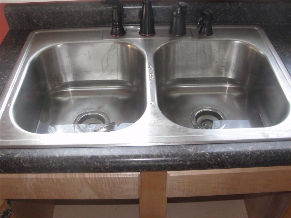 Just drop a couple denture cleaning tablets down the kitchen drain, along with a cup of hot water.