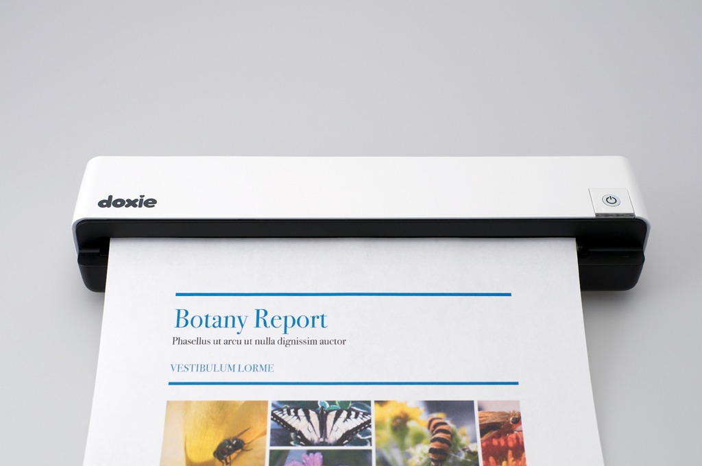 The Doxie Scanner by Apparent is my favorite portable scanner. Use to quickly clear paper clutter - on the go!