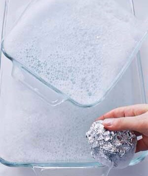 To get baked-on food off a glass pan or an oven rack, use dishwashing liquid and a ball of foil in place of a steel-wool soap pad, says Mary Findley, president of the cleaning-products developer Mary Moppins. It's one way to recycle those used but perfectly good pieces of foil you hate to throw out.
