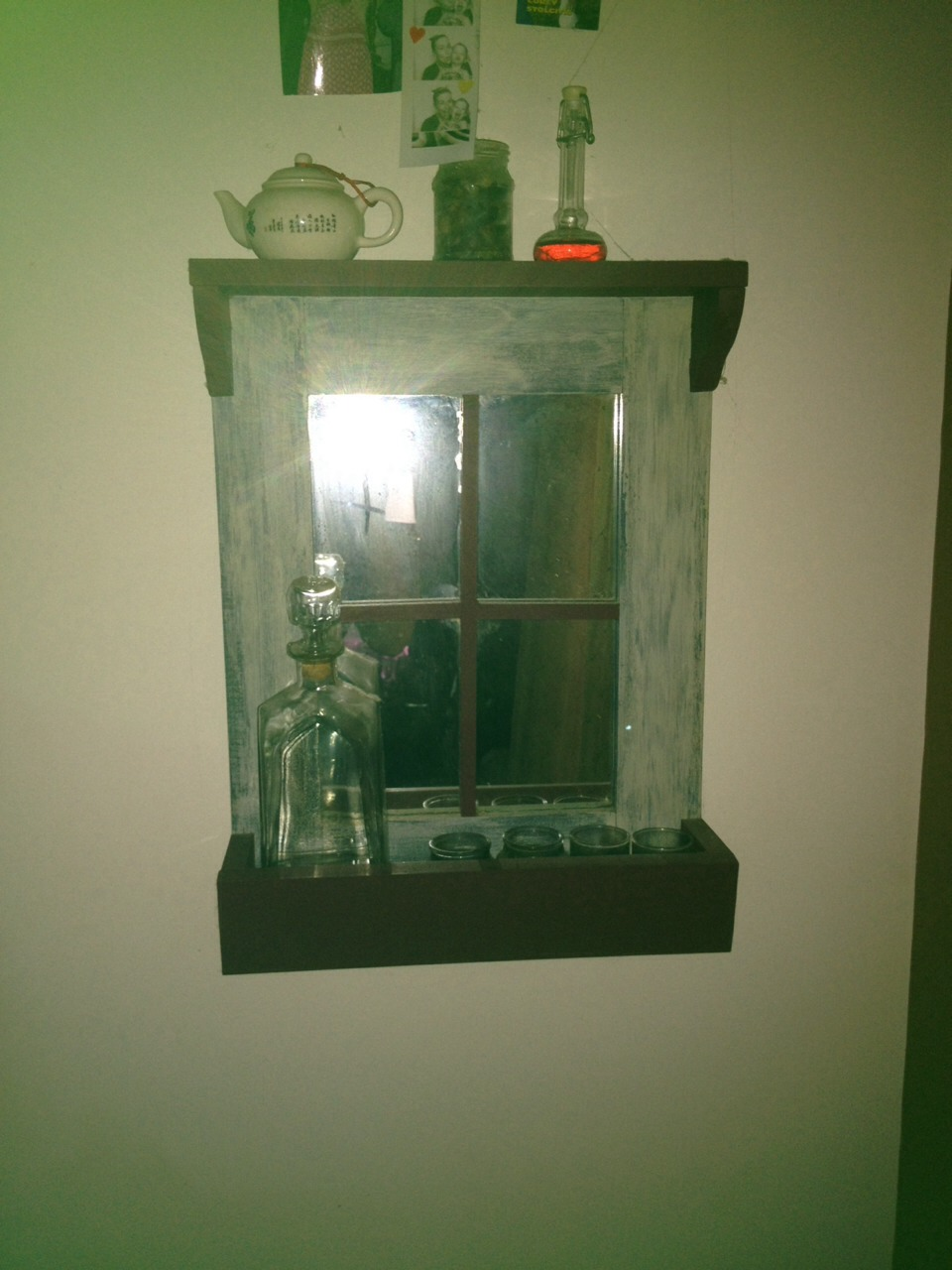 I also made this out of one 1inch by 4inch board some wood glue and finishing nails then I glued an old mirror to the back and added the 2strips of wood to make it look like an old window frame.,,