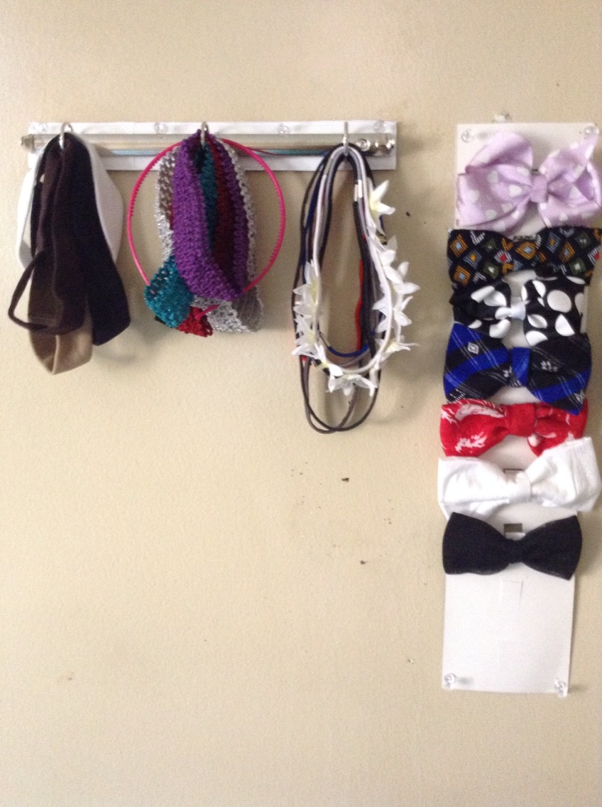 Use the rings of an old binder and a poster paper to organize and display your headbands and bows.