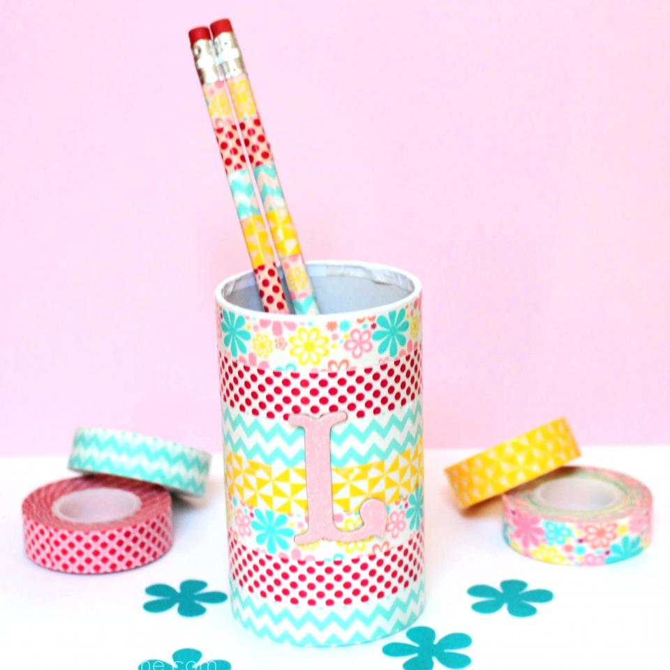 Washi tape covered cups, jars, or even toilet paper rolls make cool pencil holders. Just make sure to put a sturdier tape layer on the bottle if you plan on using toilet paper rolls.
