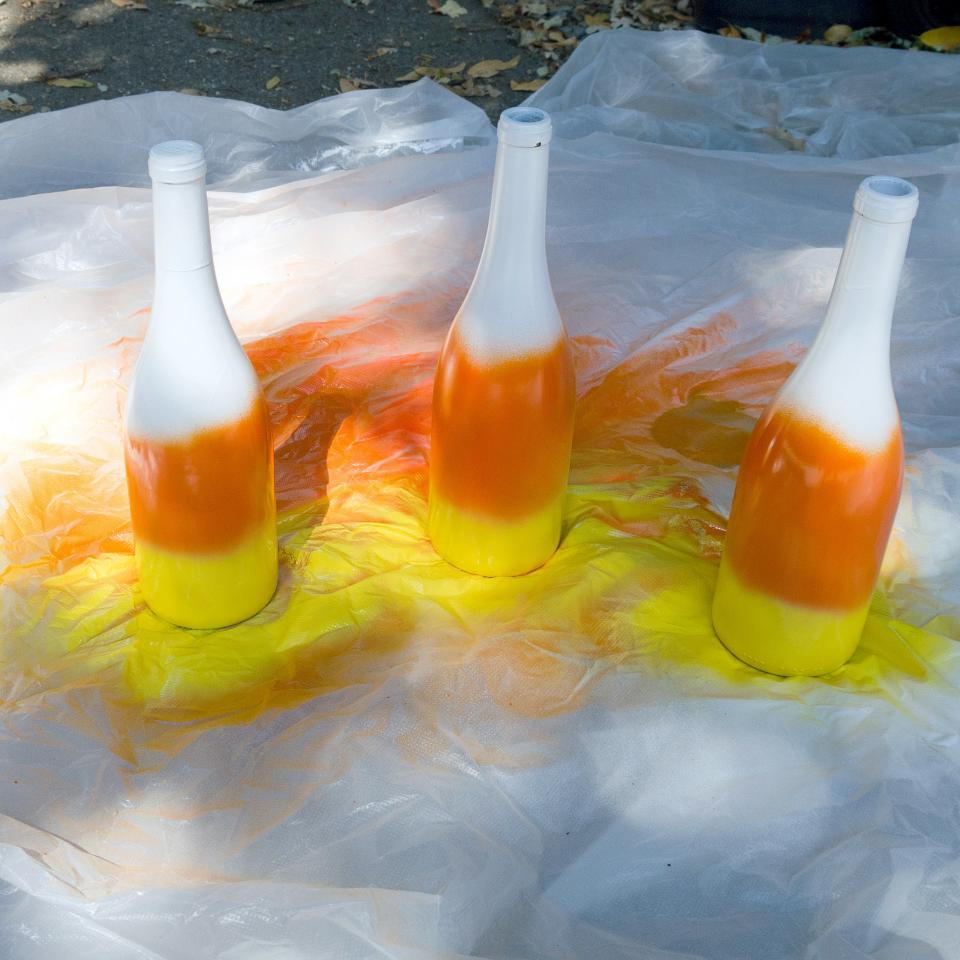 Finish the bottle with a layer of yellow spray paint around the base of the bottle and let dry for another 20 minutes. Touch up as needed.