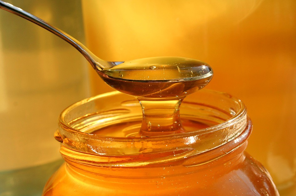 First, you're going to put one tablespoon of honey into a mixing bowl.