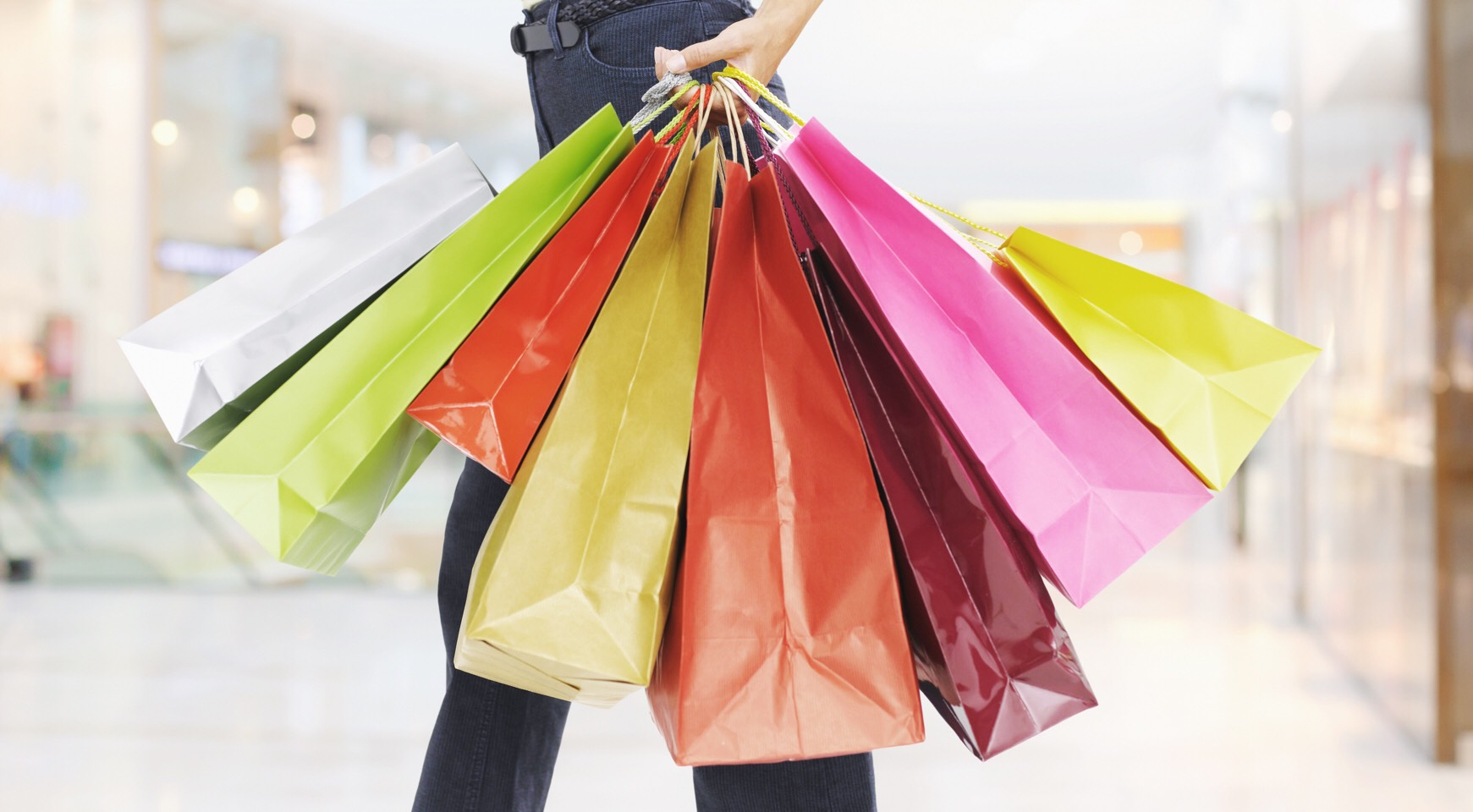 Look for an outlet mall to go to first (they're usually cheaper). Figure out what you really need to buy. The day before you go out, try on all your clothes, and take note of what you don't have a lot of and really need. Make a list, check it twice - you are your own Santa Clause this summer.