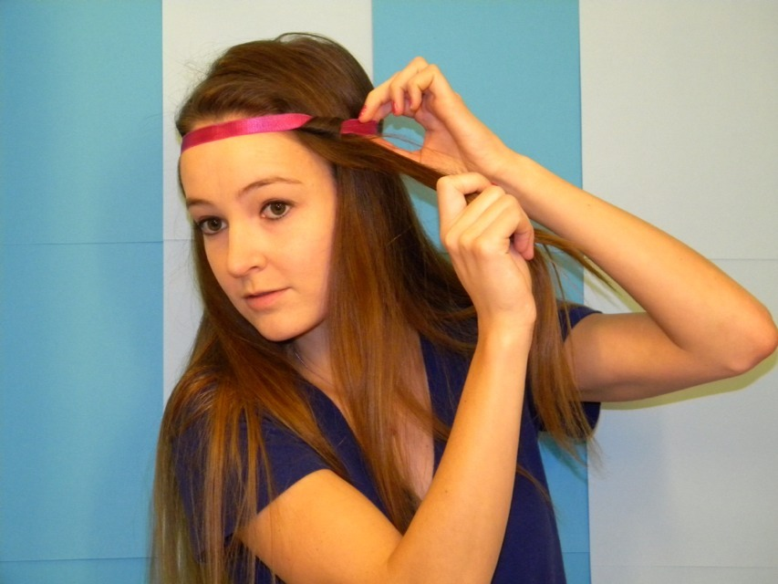 Take a head band and start to rap your hair around it