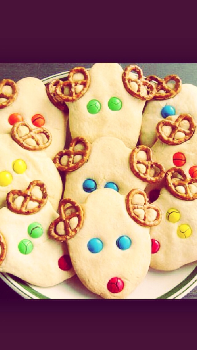 Easy and cute DIY cookies!   Step 1: prepare or purchase favorite shortbread dough Step 2: cut out reindeer shape with cutter Step 3: add pretzels as antlers, and smarties/m&m's for the eyes and nose Step 4: bake, cool and enjoy!