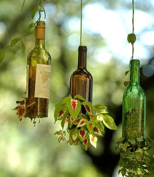 The planters are made from actual wine bottles. The most difficult part will be to cut off the bottom part of the bottles. This way your plants will be able to beautifully grow inside the bottle and then expand outside its limits.