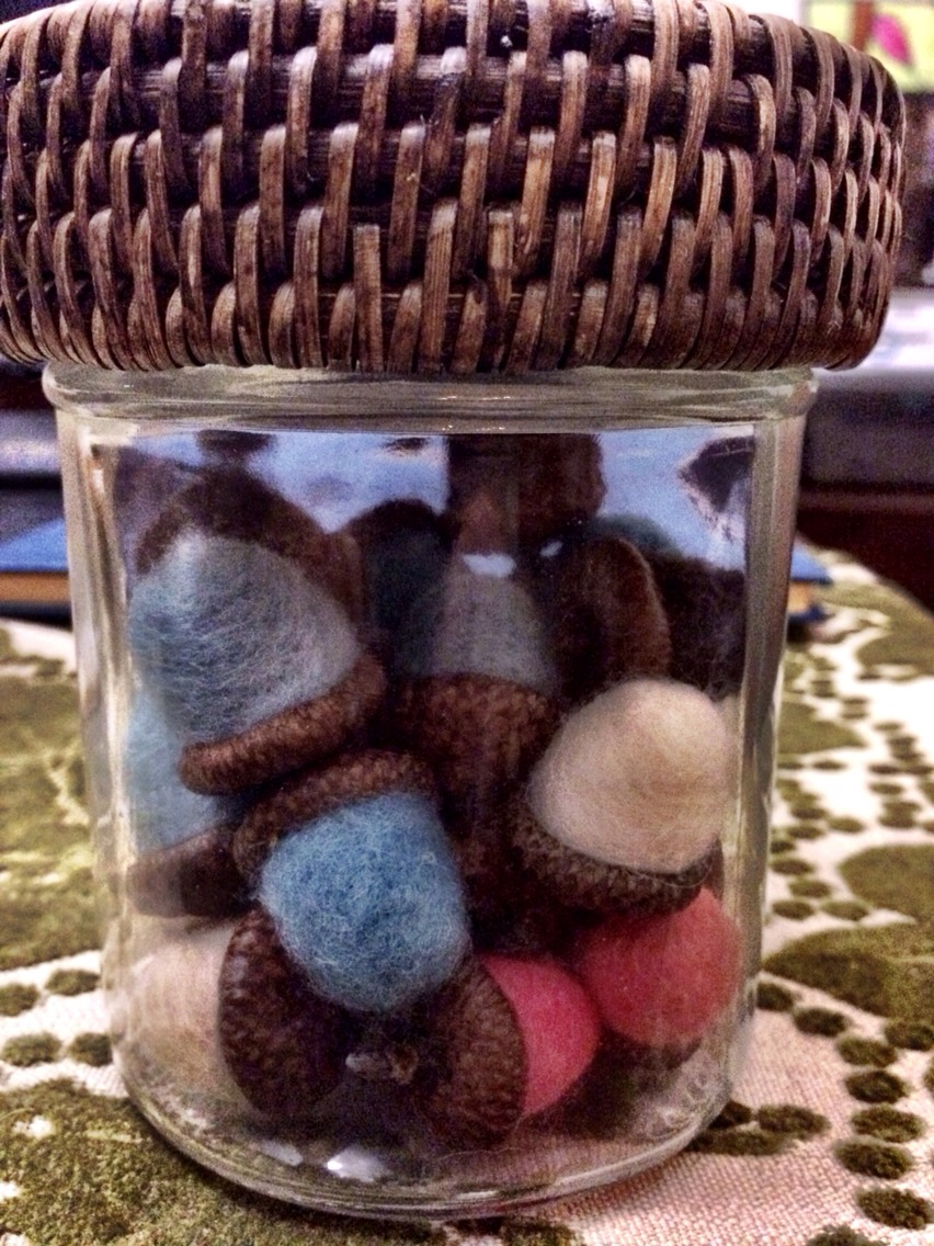 Glue acorn caps onto the dried wool balls. You can use different colored wool or paint the acorn caps to match your style!