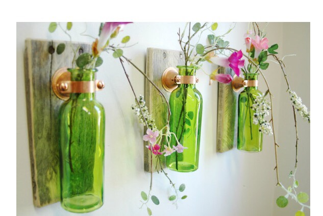 Instead of throwing away your old wine bottles turn them into pieces of art.