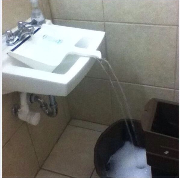 Use a clean dustpan to fill a container that doesn't fit under the tap