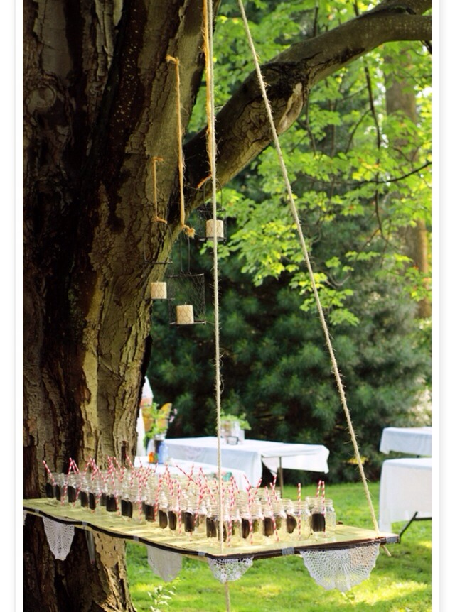 20. Suspend tables from the trees with rope.