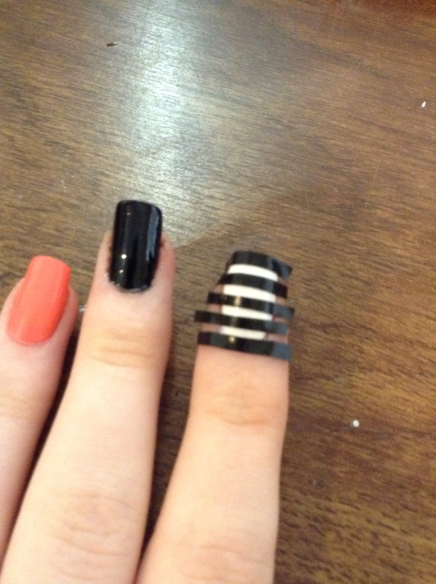 Wait for the nails to completely dry and then put tape on the nail to make stripes.