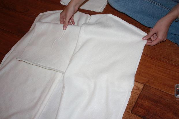 Next is sew the sleeves onto the body.