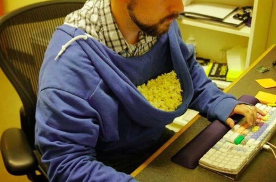 Popcorn Hoodie This serves a dual purpose 1. it creates a large bowl close to your mouth 2. It catches the one's you try to mouth catch and miss (no clean-up).
