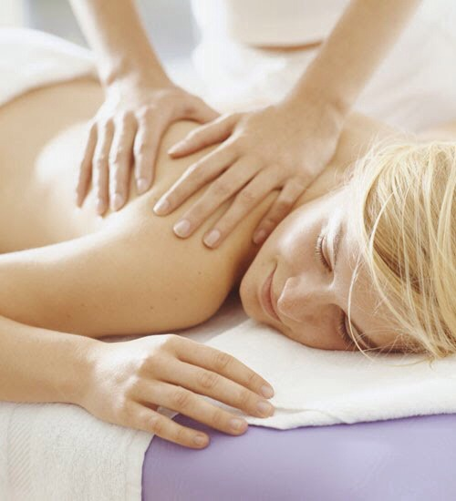 """Get a Massage  This step is a way to """"practice"""" being nude by spending time in an environment where it's okay. It's also an effective way of becoming more closely acquainted with your body, so that you can grow to like and appreciate it more."""