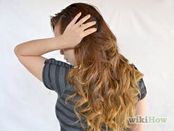 Examine your hair. Look at the sides of your head and put up a mirror to the back of your head to make sure that you've evenly curled your hair. If one side is a lot curlier than the other, just try to make some more beach waves on the other side for balance.