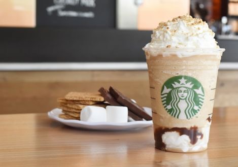 Finally, pour the frappuccino into the cup and top it off with whipped cream and crumbled graham crackers