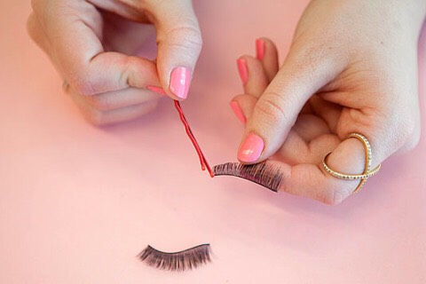 Apply eyelash glue to false lashes with the tip of a clean bobby pin