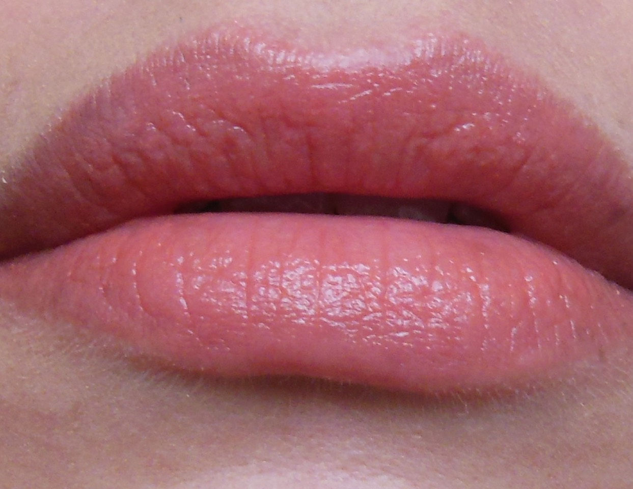 Apply a lip balm on your lips before your lipstick to make a sheer lipstick/ lip balm.