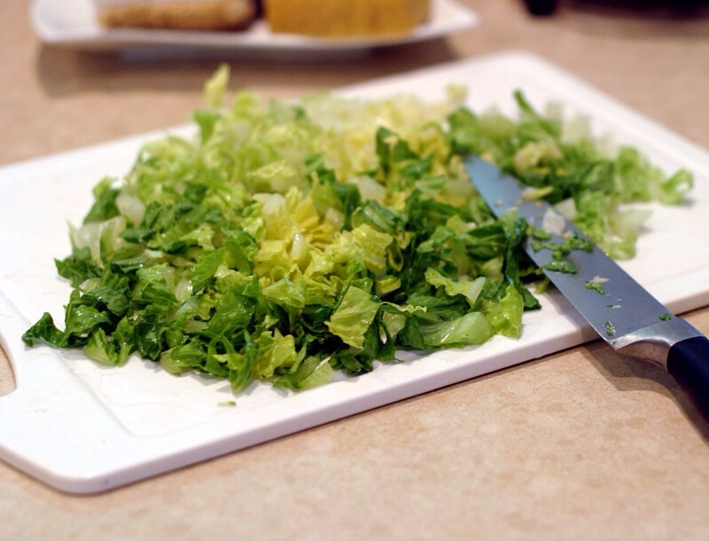 Top with Chopped lettuce and then mozzarella cheese. You can use chopped cilantro instead of lettuce if you prefer.