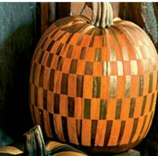 try different mediums sharpies, acrylic paint, a stencil with spray paint) be careful to tape the rest of the pumpkin, use spray adhesive so there are nogaps between stencil and pumpkin, spray lightly from far away and of course work in a well ventilated area