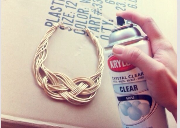 Spray clear gloss onto cheap jewelry to keep from turning green! Also makes it hypoallergenic :)