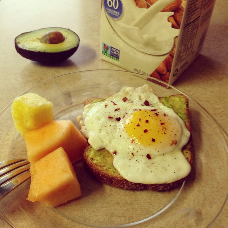 Cook your egg sunny side up, pop your whole wheat toast in the toaster, spread 1/2 of a delicious avocado onto your toast, put your egg on top of the delicious avocado spread and voila! Add some fruit of your choice and pour yourself a glass of almond milk! Fast, simple, and so satisfying!